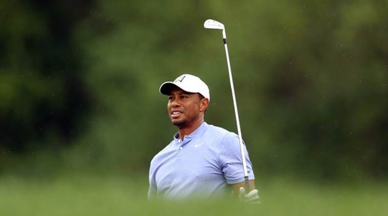 Tiger Woods shrugs off shaky start to lead in Japan