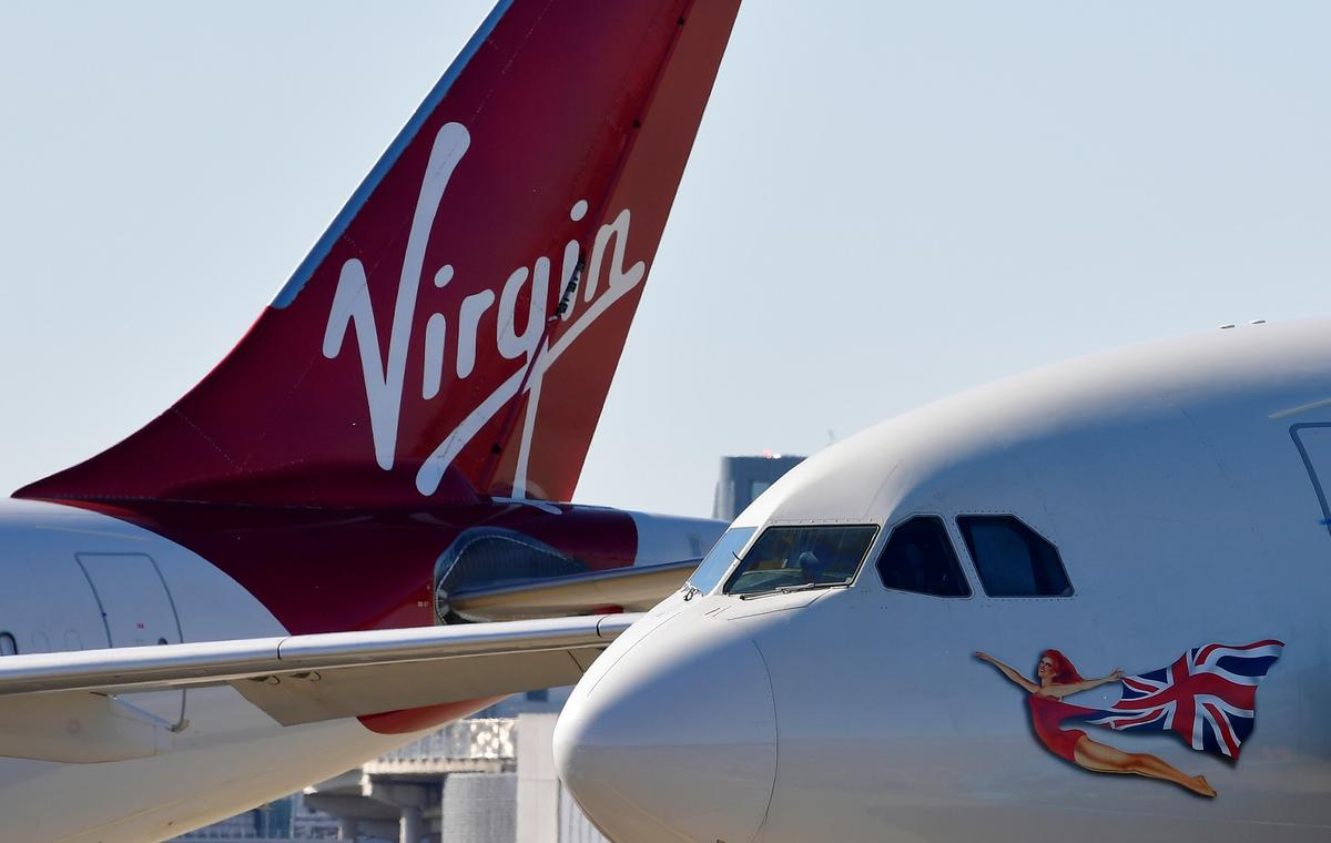 Virgin Atlantic to cut over 1,000 more jobs as demand languishes – Sky News – Reuters